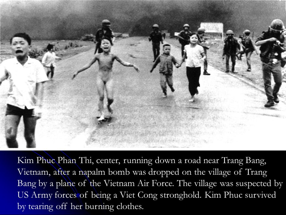 Kim Phuc Phan Thi, center, running down a road near Trang Bang, Vietnam, after a napalm bomb was dropped on the village of Trang Bang by a plane of th