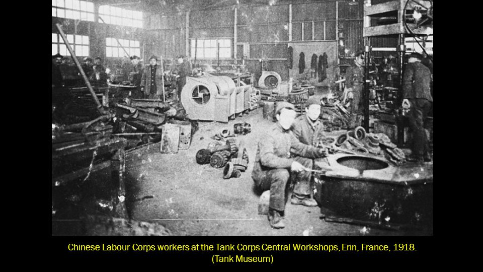 Members of the Chinese Labour Corps carry out riveting work at the Central Workshops of the Tank Corps, British Forces.