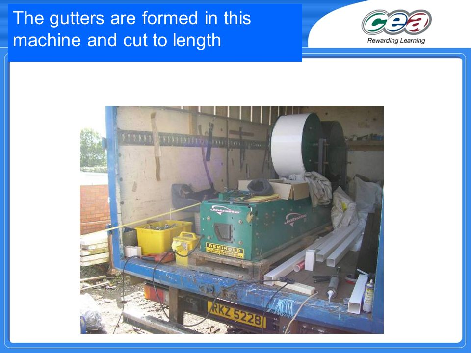 The gutters are formed in this machine and cut to length