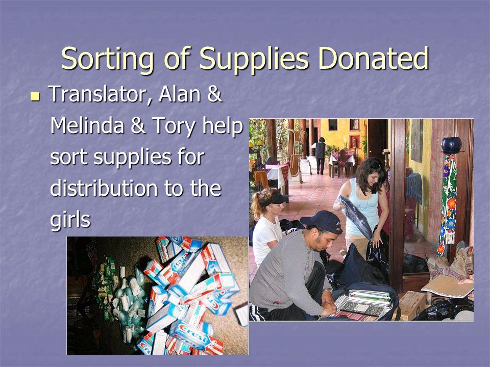 Sorting of Supplies Donated Translator, Alan & Translator, Alan & Melinda & Tory help Melinda & Tory help sort supplies for sort supplies for distribu