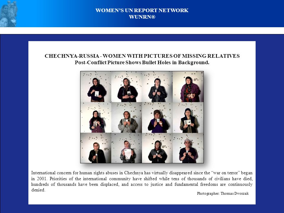 CHECHNYA-RUSSIA - WOMEN WITH PICTURES OF MISSING RELATIVES Post-Conflict Picture Shows Bullet Holes in Background.