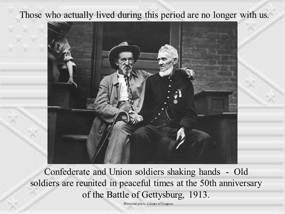 Confederate and Union soldiers shaking hands - Old soldiers are reunited in peaceful times at the 50th anniversary of the Battle of Gettysburg, 1913.