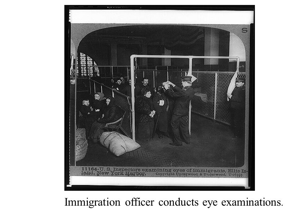 Immigration officer conducts eye examinations.