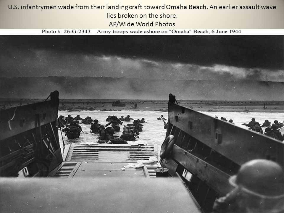 U.S. infantrymen wade from their landing craft toward Omaha Beach. An earlier assault wave lies broken on the shore. AP/Wide World Photos