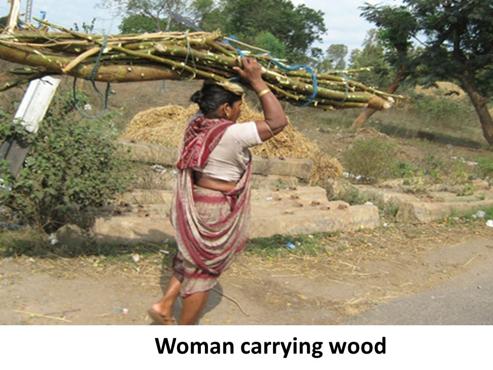 Woman carrying wood
