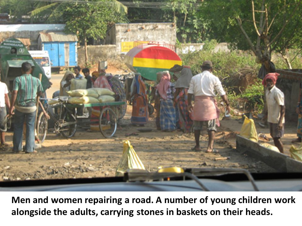 Men and women repairing a road.