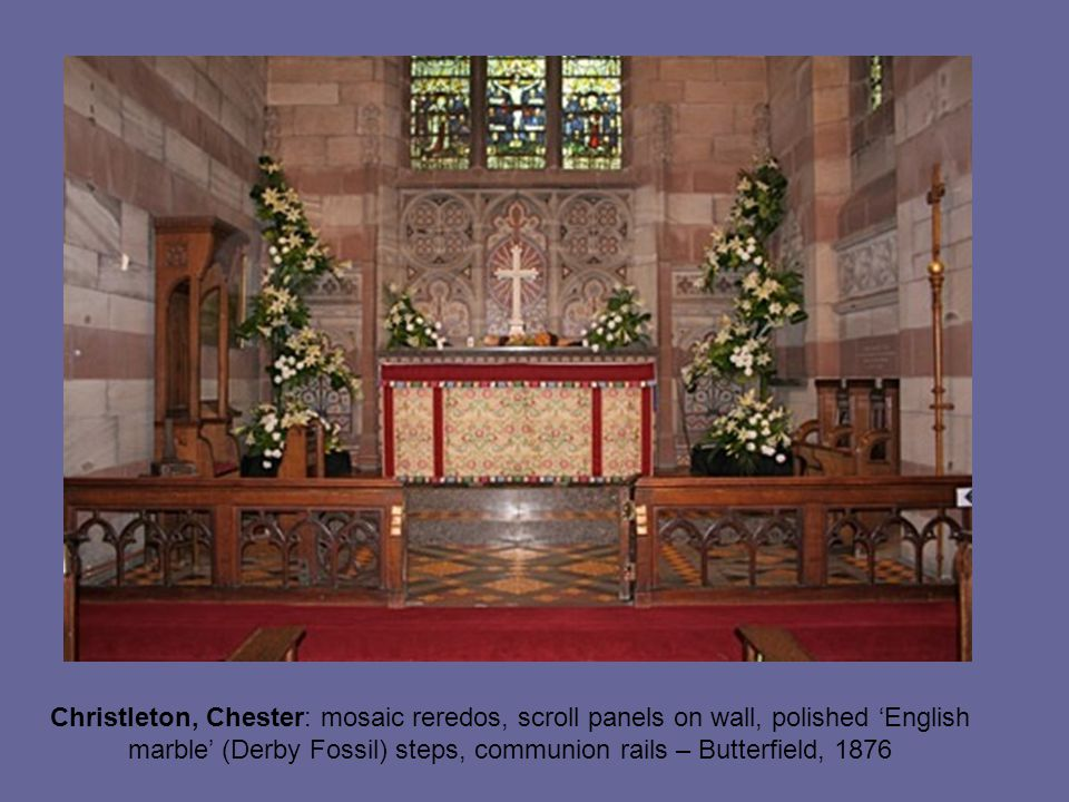 Christleton, Chester: mosaic reredos, scroll panels on wall, polished 'English marble' (Derby Fossil) steps, communion rails – Butterfield, 1876