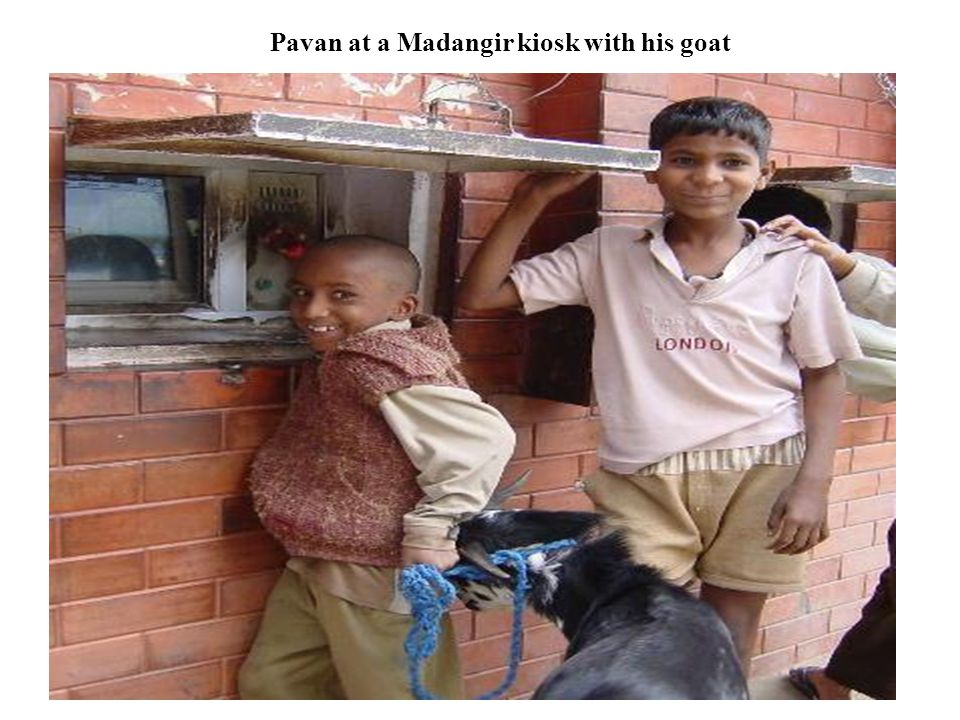 Pavan at a Madangir kiosk with his goat