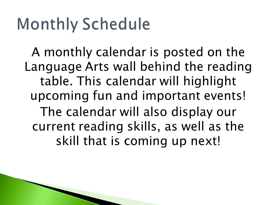 A monthly calendar is posted on the Language Arts wall behind the reading table.