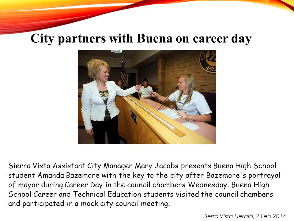 Sierra Vista Assistant City Manager Mary Jacobs presents Buena High School student Amanda Bazemore with the key to the city after Bazemore's portrayal