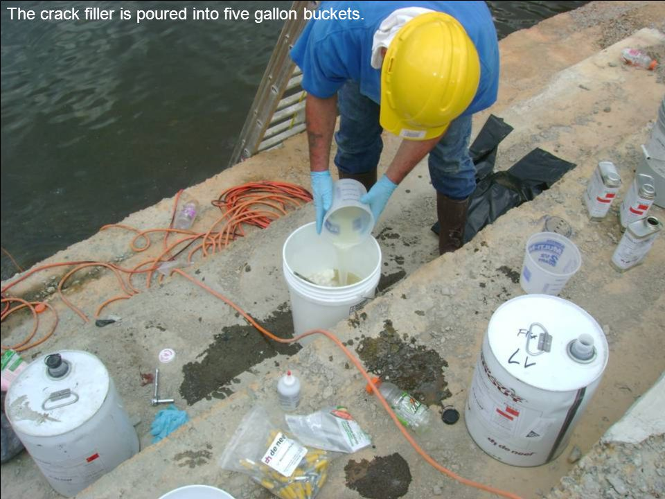 The crack filler is poured into five gallon buckets.