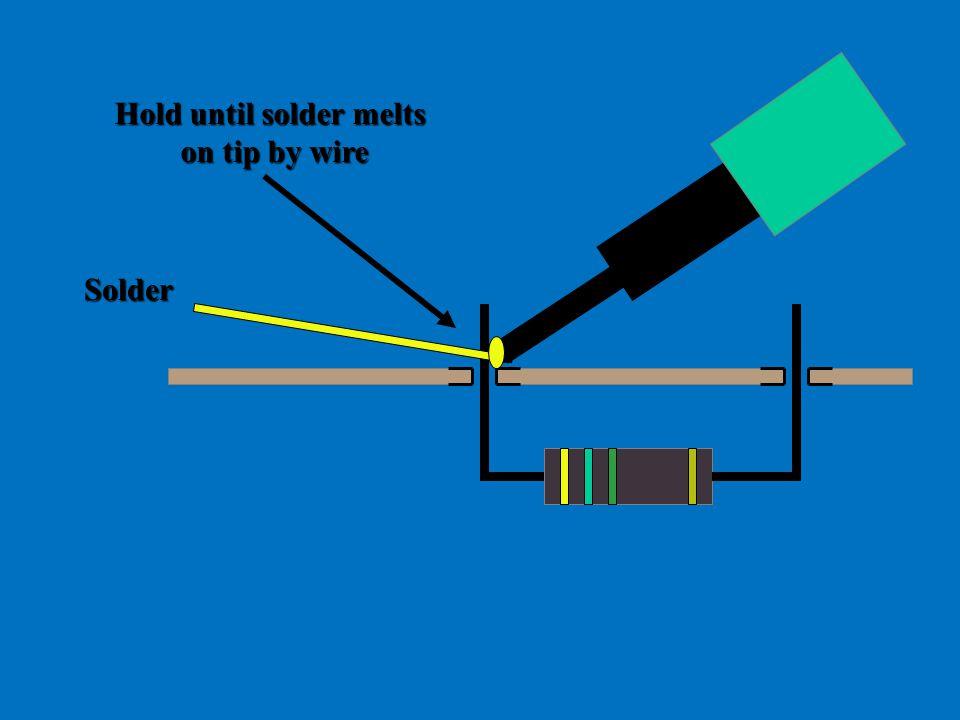 Hold until solder melts on tip by wire Solder