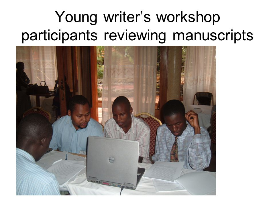 Young writer's workshop participants reviewing manuscripts.