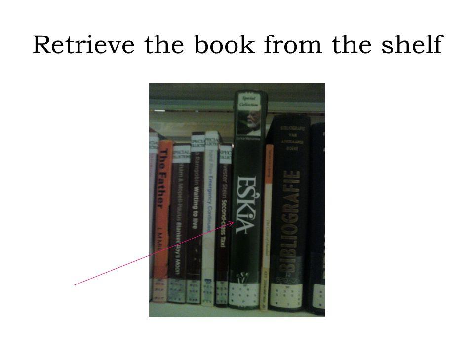 Retrieve the book from the shelf