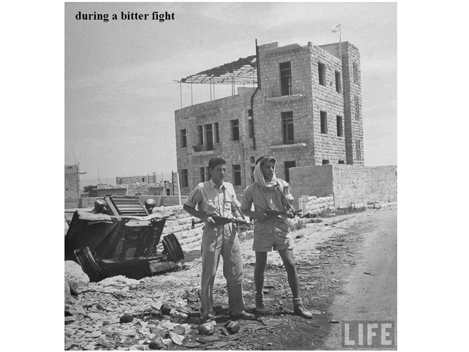 Ronnie (L) a Haganah officer, walking down the street
