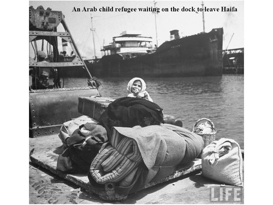An Arab child refugee waiting on the dock to leave Haifa