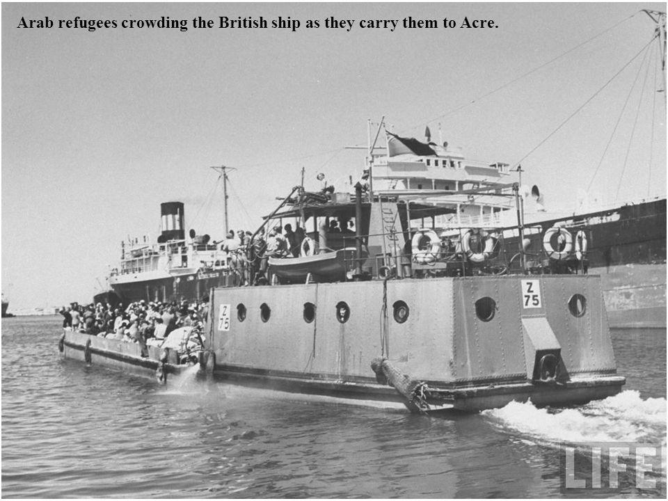 Arab refugees crowding the British ship as they carry them to Acre.