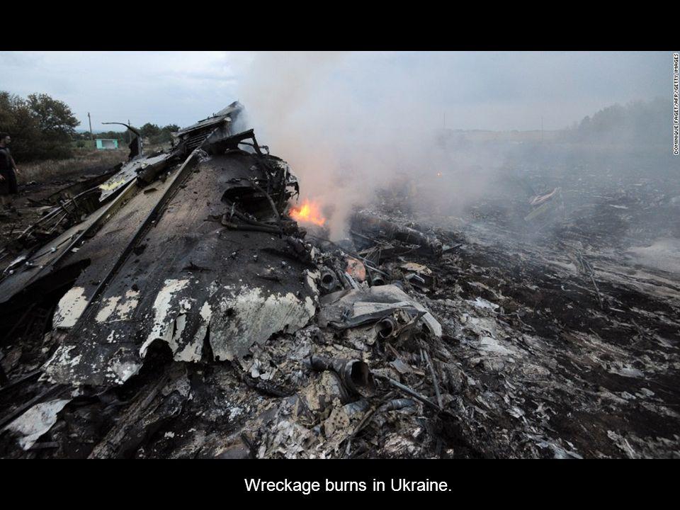 Debris smoulders in a field near the Russian border.
