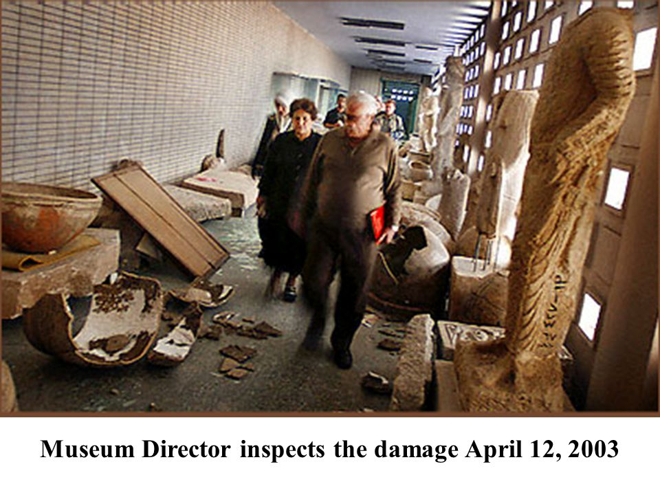 Museum Director inspects the damage April 12, 2003