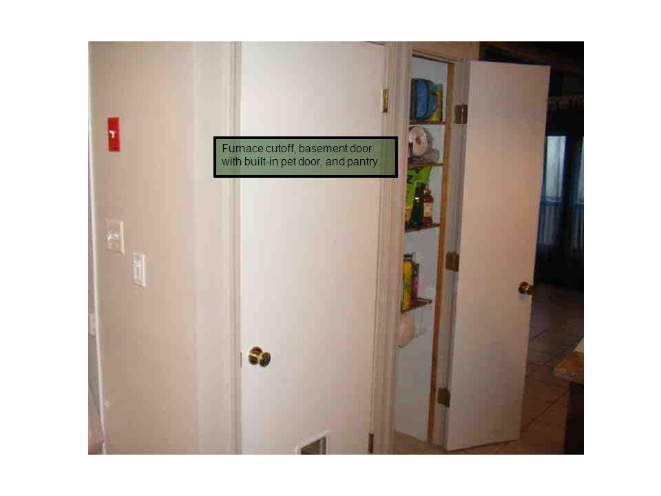 Furnace cutoff, basement door with built-in pet door, and pantry.