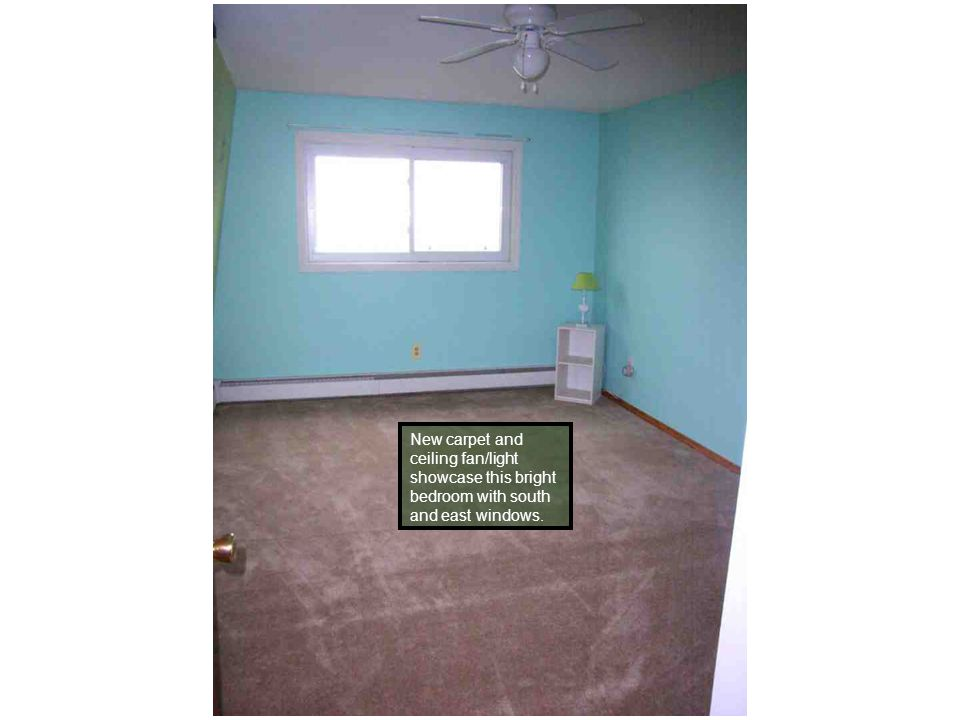 New carpet and ceiling fan/light showcase this bright bedroom with south and east windows.