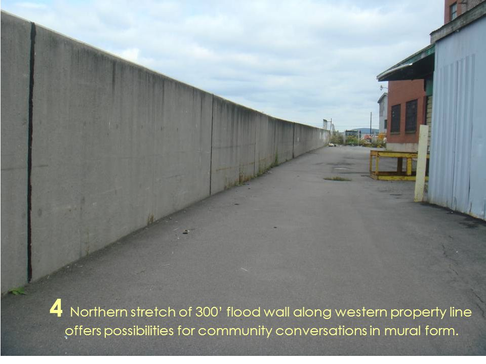 4 Northern stretch of 300' flood wall along western property line offers possibilities for community conversations in mural form.