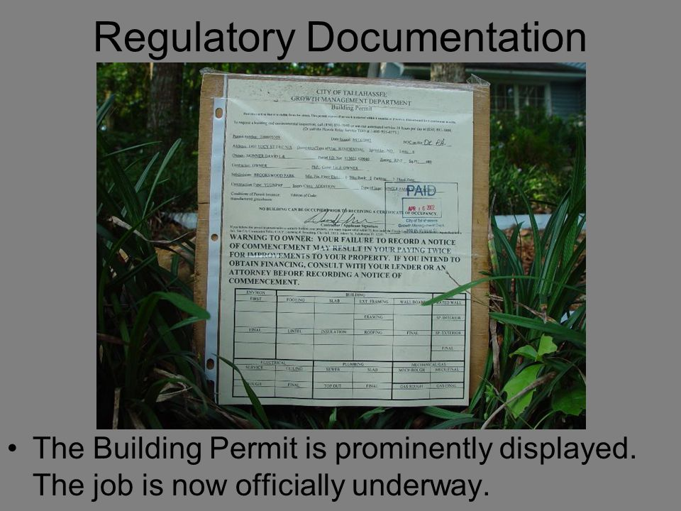 Regulatory Documentation The Building Permit is prominently displayed. The job is now officially underway.