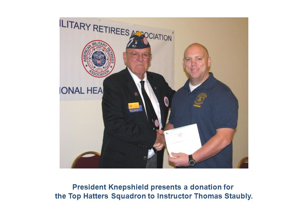 President Knepshield presents a donation for the Top Hatters Squadron to Instructor Thomas Staubly.
