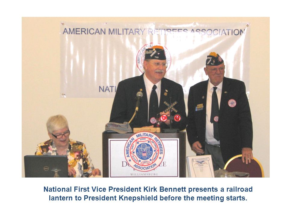 National First Vice President Kirk Bennett presents a railroad lantern to President Knepshield before the meeting starts.
