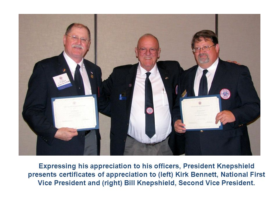 Expressing his appreciation to his officers, President Knepshield presents certificates of appreciation to (left) Kirk Bennett, National First Vice Pr