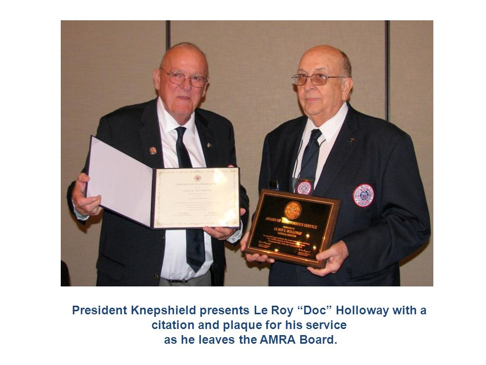 """President Knepshield presents Le Roy """"Doc"""" Holloway with a citation and plaque for his service as he leaves the AMRA Board."""