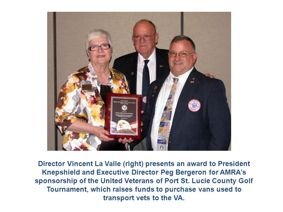 Director Vincent La Valle (right) presents an award to President Knepshield and Executive Director Peg Bergeron for AMRA's sponsorship of the United V