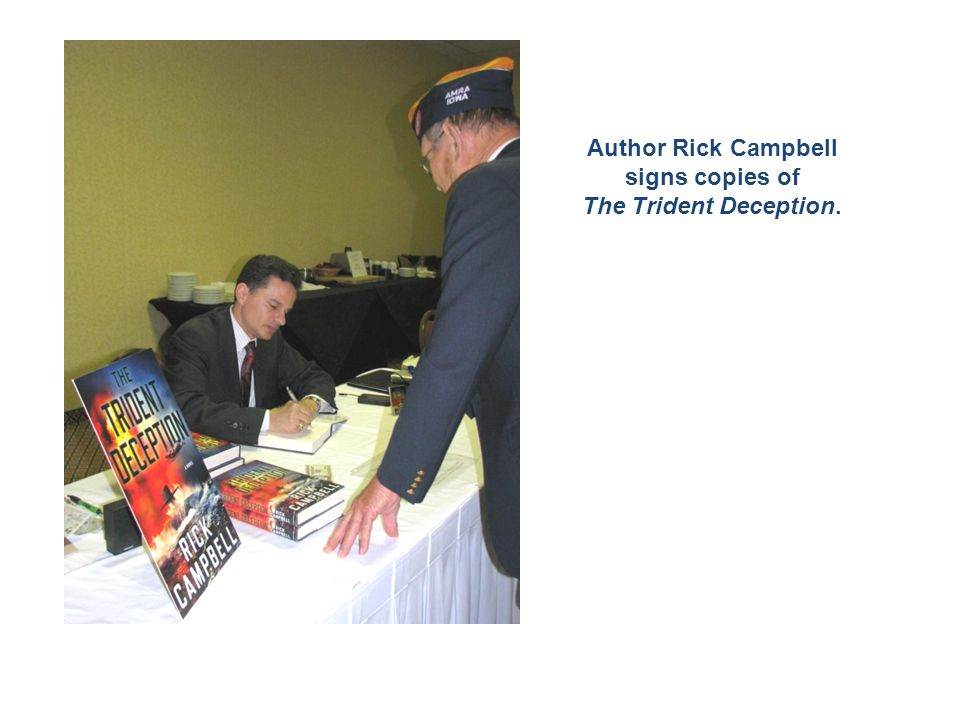 Author Rick Campbell signs copies of The Trident Deception.