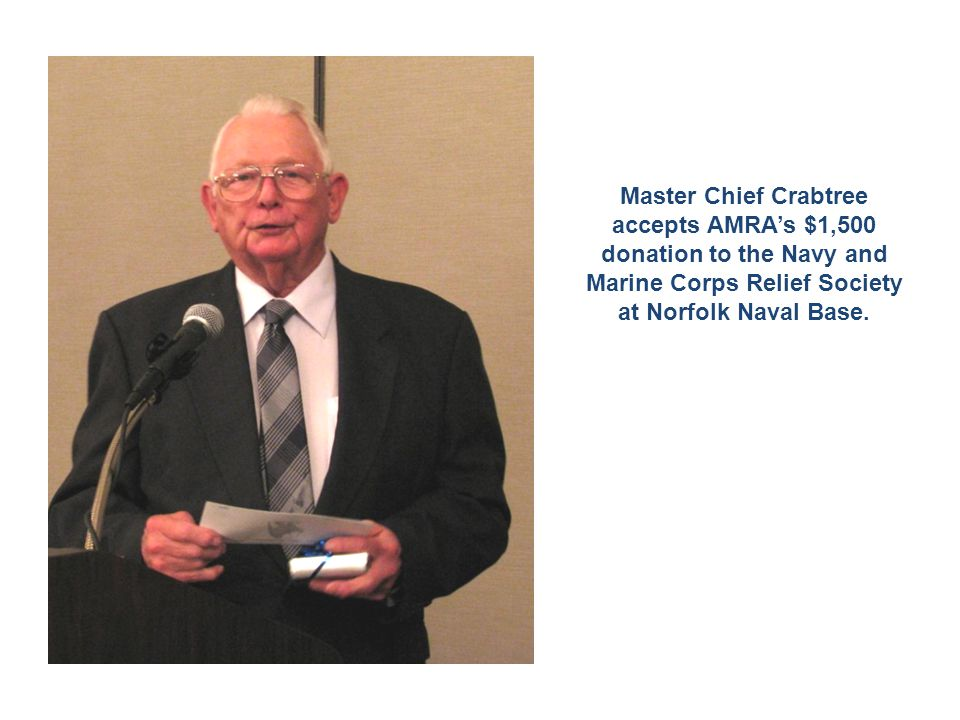 Master Chief Crabtree accepts AMRA's $1,500 donation to the Navy and Marine Corps Relief Society at Norfolk Naval Base.