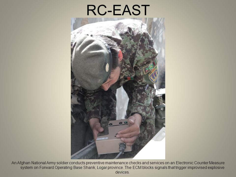 RC-EAST An Afghan National Army soldier conducts preventive maintenance checks and services on an Electronic Counter Measure system on Forward Operating Base Shank, Logar province.