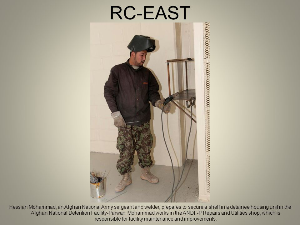 RC-EAST Hessian Mohammad, an Afghan National Army sergeant and welder, prepares to secure a shelf in a detainee housing unit in the Afghan National Detention Facility-Parwan.