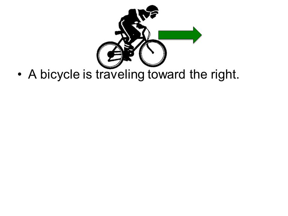 A bicycle is traveling toward the right.