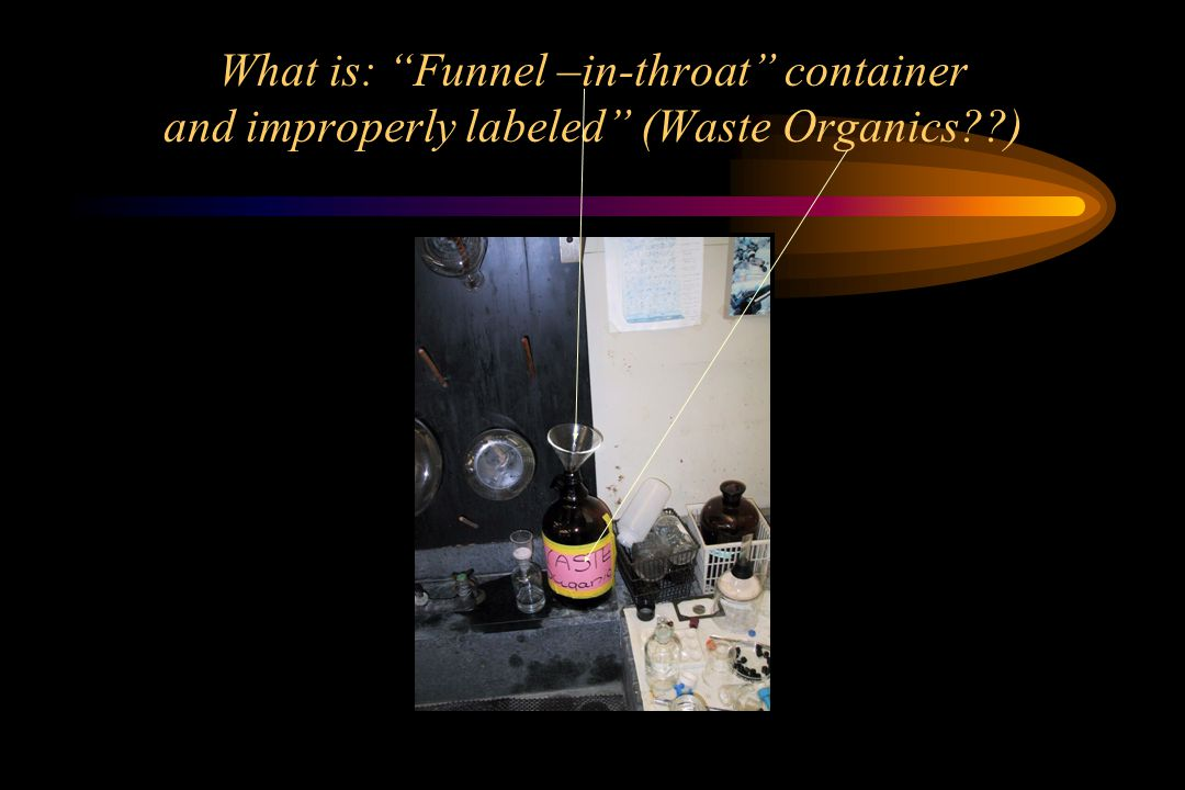 What is: Funnel –in-throat container and improperly labeled (Waste Organics )