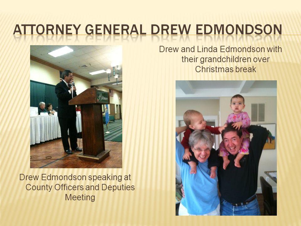 Drew Edmondson speaking at County Officers and Deputies Meeting Drew and Linda Edmondson with their grandchildren over Christmas break