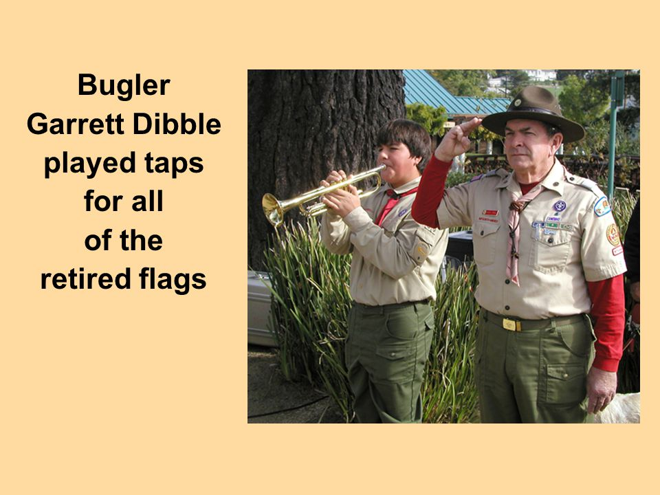 Bugler Garrett Dibble played taps for all of the retired flags