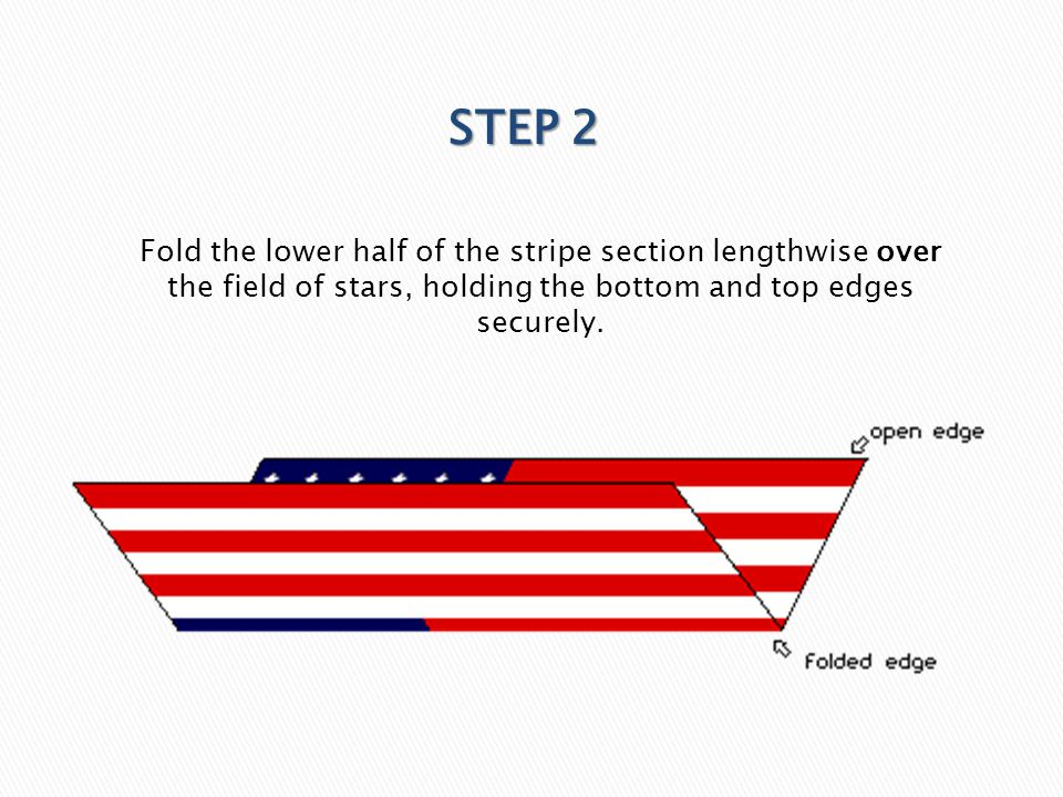 STEP 2 Fold the lower half of the stripe section lengthwise over the field of stars, holding the bottom and top edges securely.