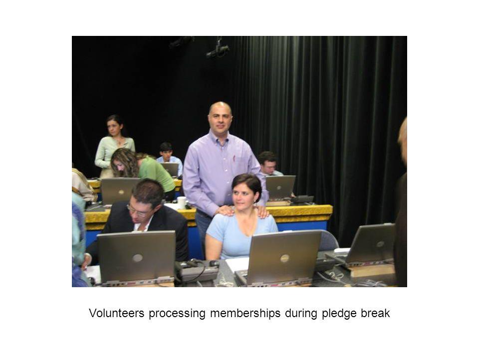 Volunteers processing memberships during pledge break