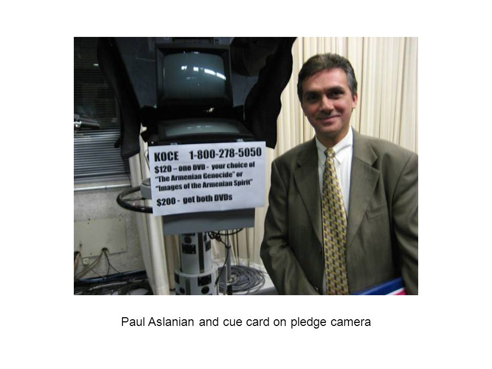 Paul Aslanian and cue card on pledge camera
