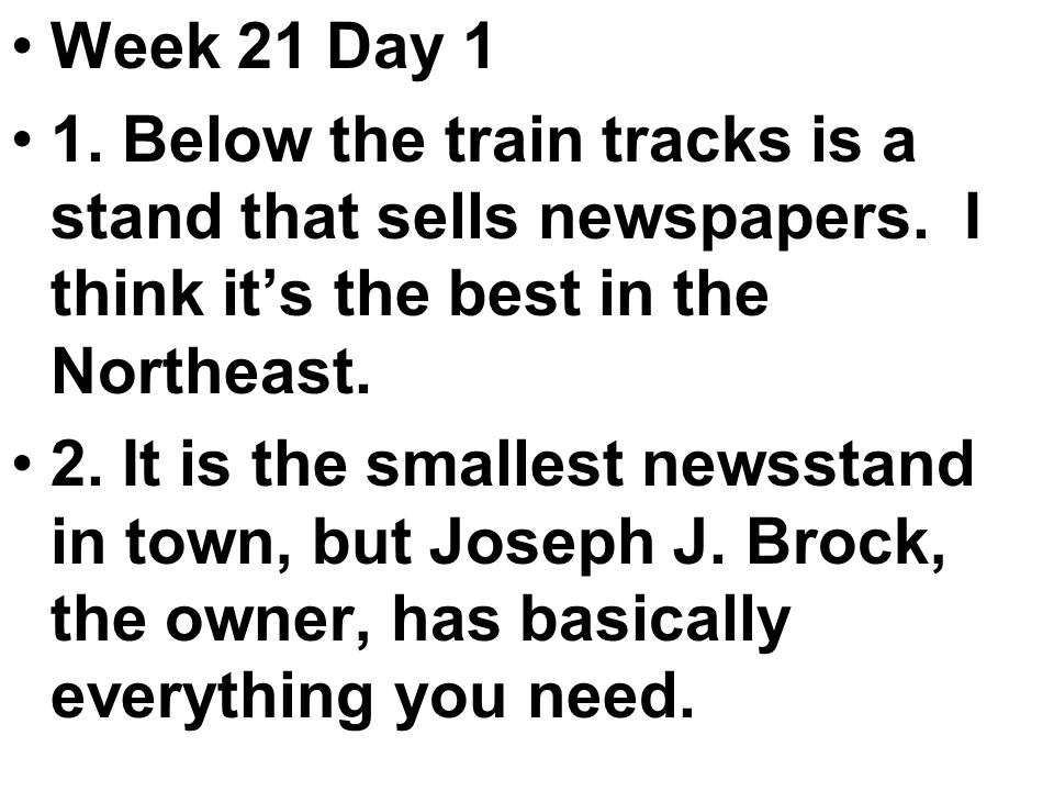 Week 21 Day 1 1. Below the train tracks is a stand that sells newspapers.