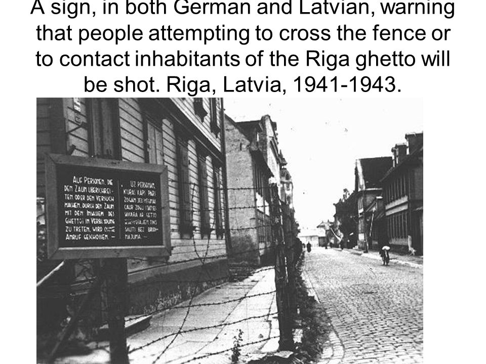 A sign, in both German and Latvian, warning that people attempting to cross the fence or to contact inhabitants of the Riga ghetto will be shot.