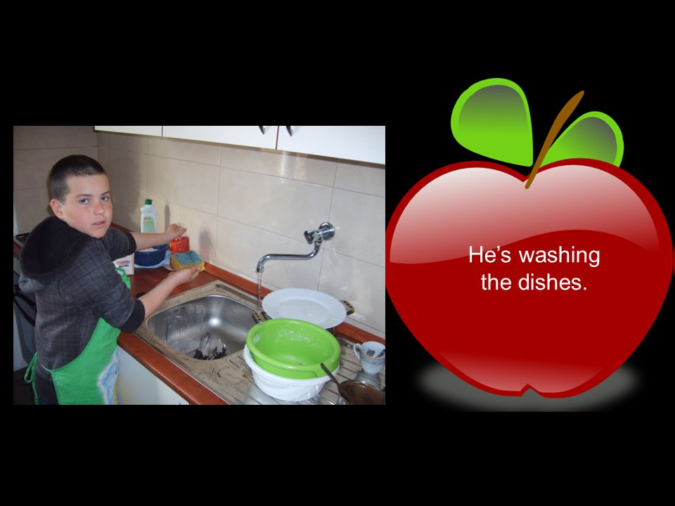 He's washing the dishes.