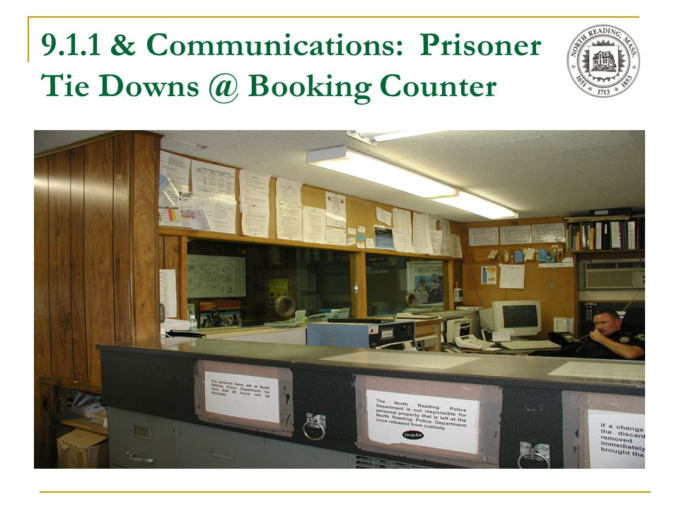 9.1.1 & Communications: Prisoner Tie Downs @ Booking Counter