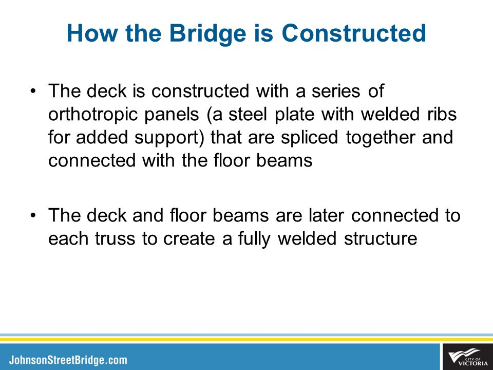 The deck is constructed with a series of orthotropic panels (a steel plate with welded ribs for added support) that are spliced together and connected with the floor beams The deck and floor beams are later connected to each truss to create a fully welded structure