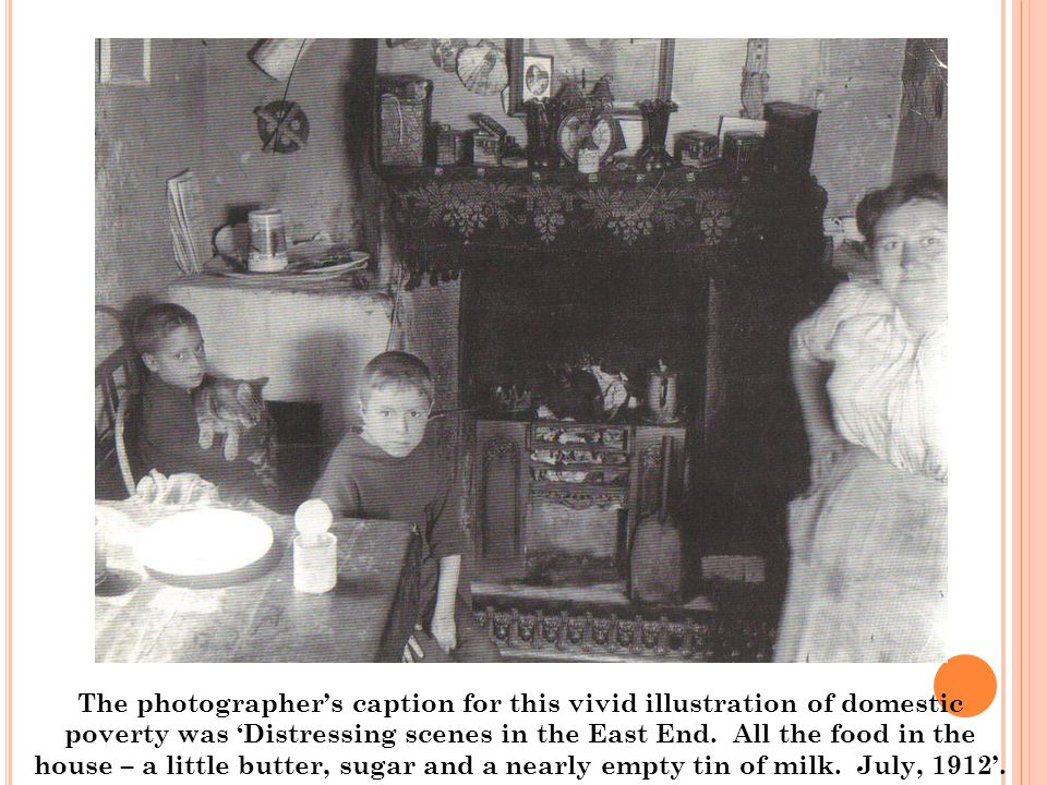 The photographer's caption for this vivid illustration of domestic poverty was 'Distressing scenes in the East End. All the food in the house – a litt