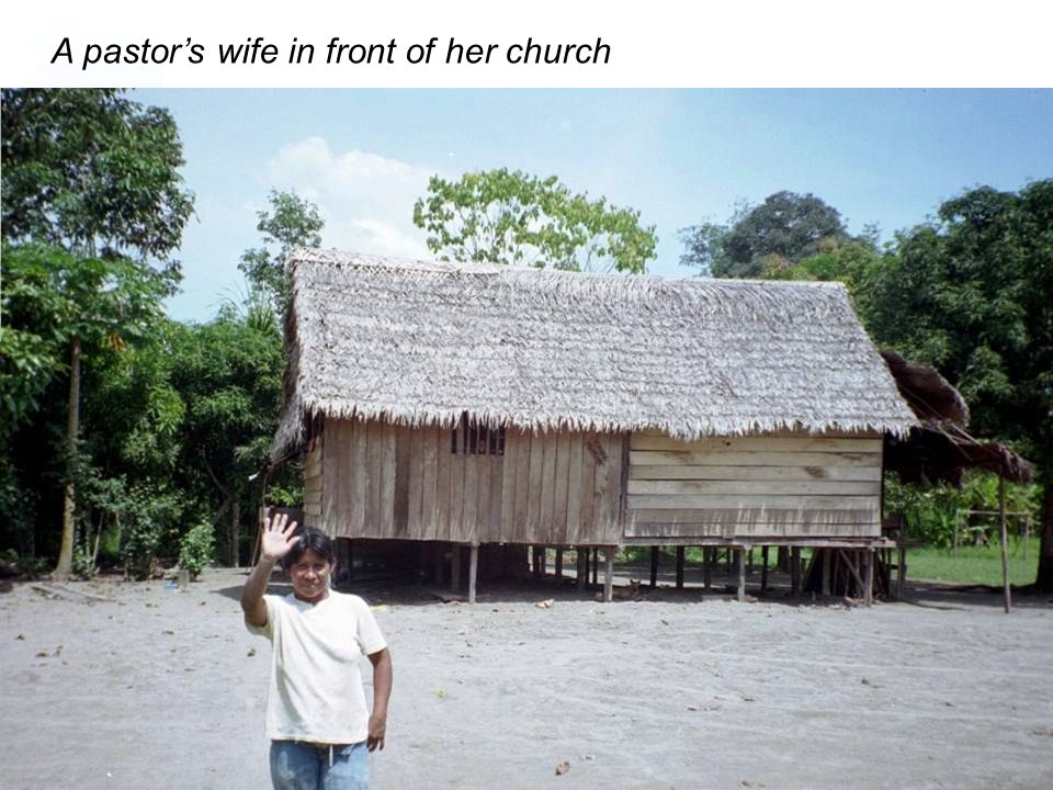 A pastor's wife in front of her church